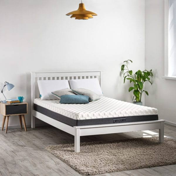 back pain mattress on a bed in a bedroom
