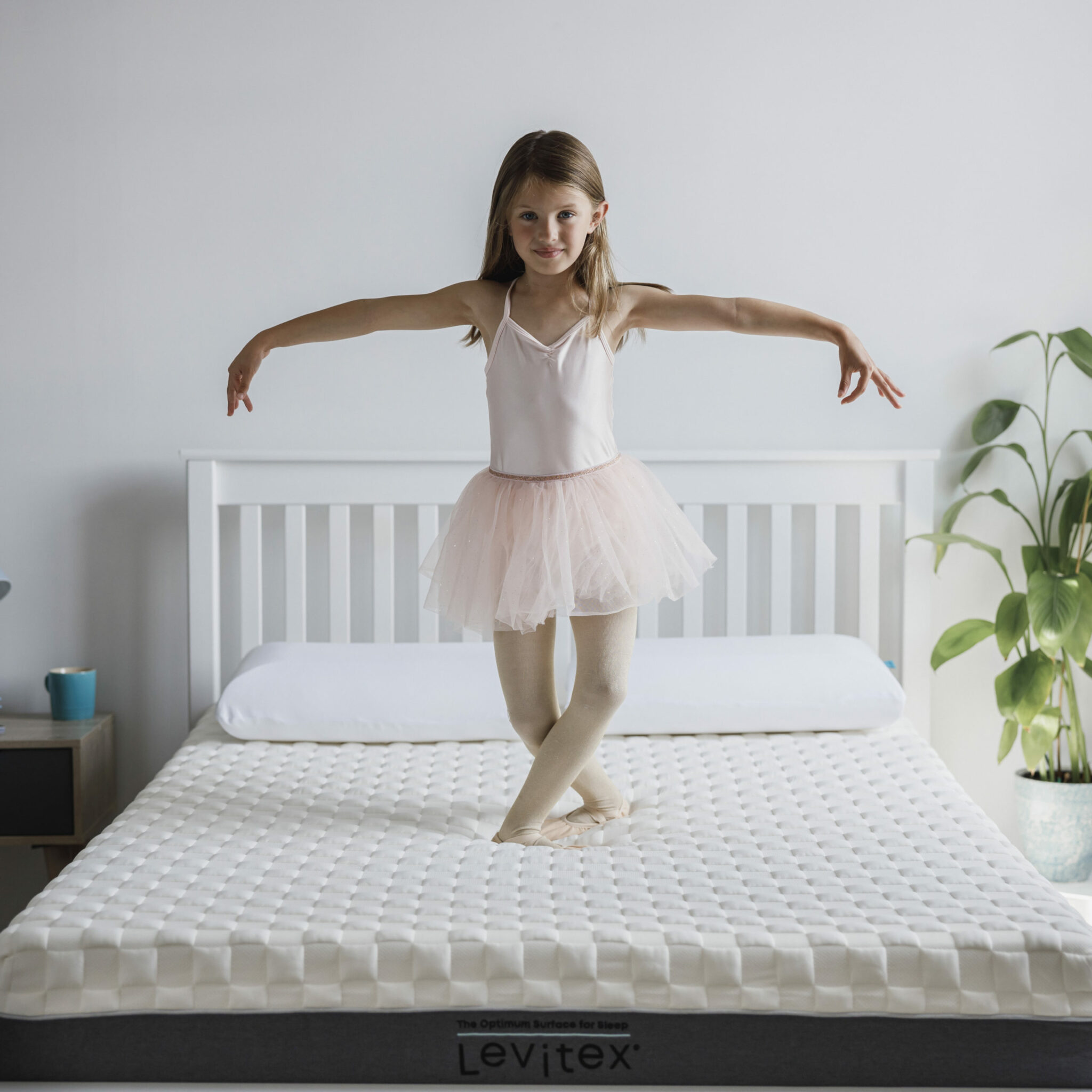 girl on back pain mattress