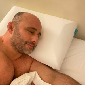 man asleep on his bed on levitex