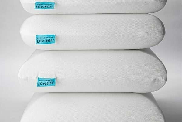 four different sizes of pillows stacked on top of one another